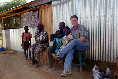 news-imageChris Barrett with farming family in Kenya